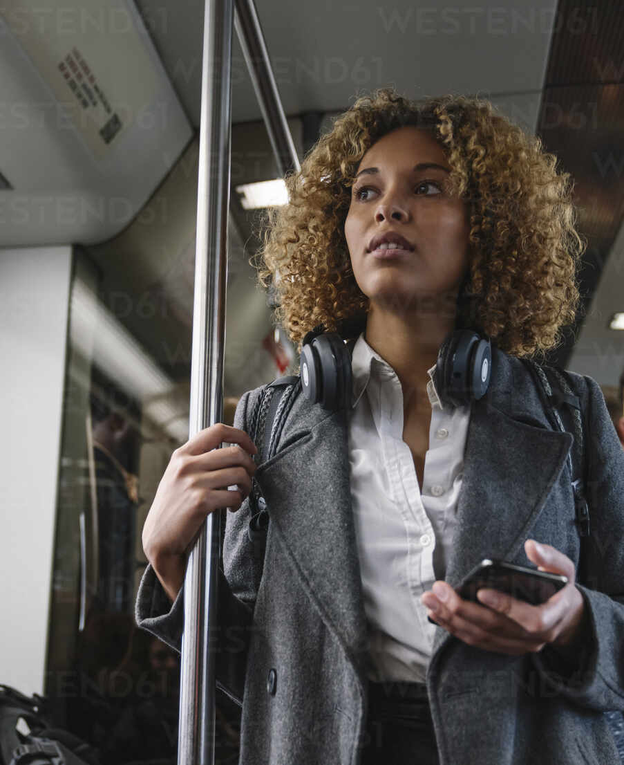 Woman with smartphone on a subway - AHSF01306 - Hernandez and Sorokina/Westend61