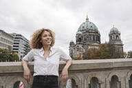 Tourist woman in the city with Berlin Cathedral in background, Berlin, Germany - AHSF01330