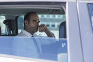 Portrait of thoughtful mature businessman in car - UUF19727