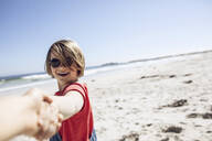 Portrait of smiling girl holding hands on the beach, Cape Town, Western Cape, South Africa - MCF00372