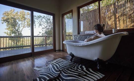 Woman having a relaxing bath in the bathtub - VEGF00826