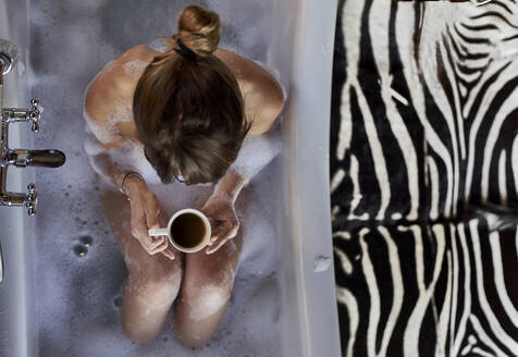 Woman having a relaxing bath and a cup of coffee in the bathtub - VEGF00838