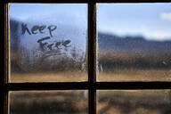 The words keep free written on a steamed windowpane - VEGF00851
