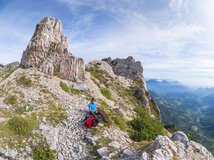 Senior hiker looking at view in he mountains, Recoaro Terme, Veneto, Italy - LAF02424