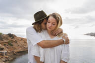 Young couple in love standing in front of the sea, Ibiza, Balearic Islands, Spain - AFVF04258