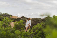 Kissing young couple in nature, Ibiza, Balearic Islands, Spain - AFVF04264