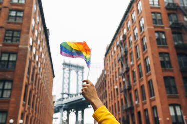 Hand waving LGBT flag in NYC, USA - JCMF00293