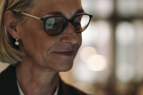 Portrait of mature businesswoman wearing glasses - GUSF02888