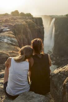 Two women enjoying the view to Victoria Falls, Zimbabwe - VEGF00871