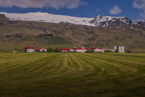 Landscape with distant row of houses and ice cap, Eyjafjallajökull, Iceland - ISF22964