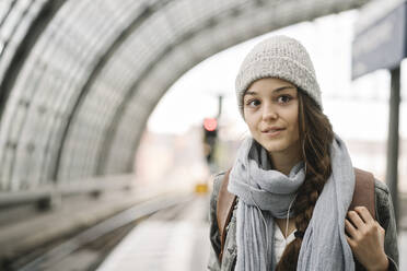 Portrait of a young woman waiting at the station platform, Berlin, Germany - AHSF01485