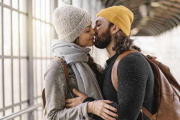 Affectionate young couple kissing at a subway station, Berlin, Germany - AHSF01494