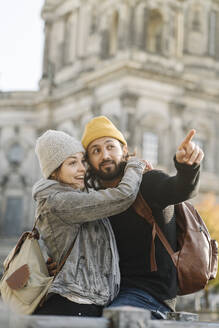 Happy young couple in the city with Berlin Cathedral in background, Berlin, Germany - AHSF01515