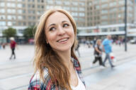 Portrait of a happy woman in the city, Berlin, Germany - WPEF02296