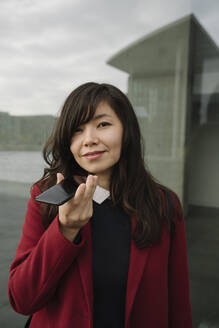 Portrait of businesswoman using smartphone - AHSF01521