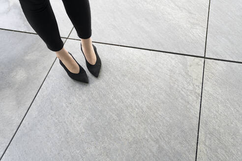 View of legs of the woman with shoes on floor - AHSF01524