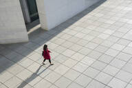 View from above of walking modern businesswoman on a concrete floor - AHSF01542