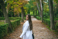 Portrait of a woman walking in a park - KIJF02844