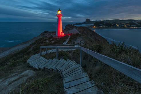 Illuminated lighthouse at dusk, Castlepoint, New Zealand - FOF11251