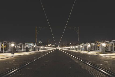 Portugal, Porto District,Porto, Illuminated railroad track across Dom Luis I Bridge at night - WPEF02386