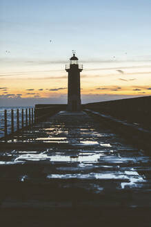 Portugal, Porto District, Porto, Silhouette of Felgueiras Lighthouse against sky at dusk - WPEF02401