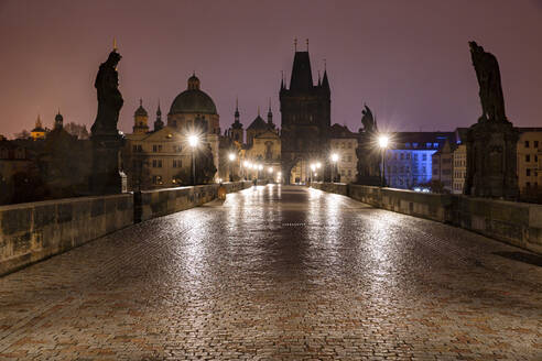 Czech Republic, Prague, Illuminated Charles Bridge at dawn - YRF00221
