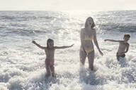 Happy mother with two kids having fun in the sea - EYAF00718
