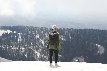 Woman with backpack enjoying mountain view, Sochi, Russia - EYAF00730
