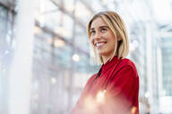 Portrait of a confident young businesswoman wearing red shirt - DIGF09012