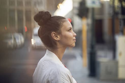 Profile view of confident young woman in the city - MCF00421