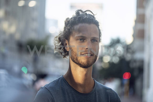 Portrait of young man in the city - MCF00424 - Maya Claussen/Westend61
