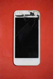 Spain, Biscay, Ermua, Studio shot of cracked smart phone - MTBF00244