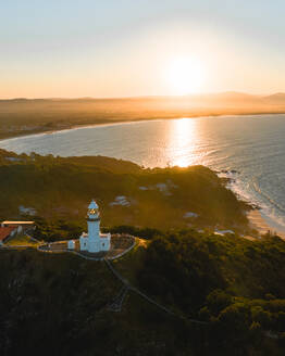 Aerial view of Byron Bay lighthouse at sunset in Australia. - AAEF05736