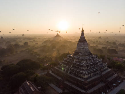 Aerial view of hot balloons flying over Bagan temples in Myanmar. - AAEF05763