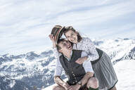Happy couple in the snowy mountains, Salzburg State, Austria - HHF05589