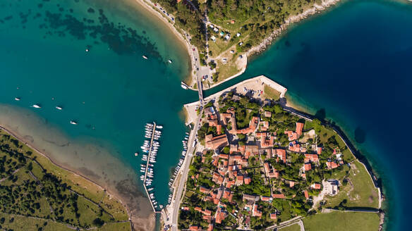 Aerial view of man-made canal crossing the city of Osor, Croatia. - AAEF05927