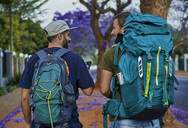 Two backpackers walking down a street - VEGF01016