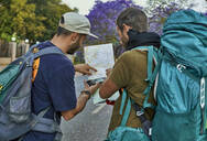 Two backpackers checking a map on a street - VEGF01019
