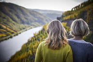 Two mature women enjoying the view from a mountain - FMKF06048