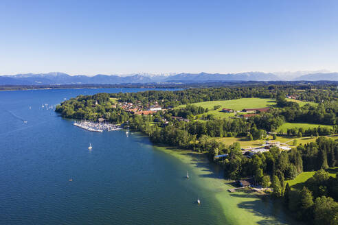 Germany, Bavaria, Bernried am Starnberger See, Aerial view of harbor on shore of Lake Starnberg with mountains in distant background - SIEF09370