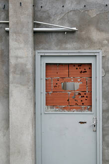Spain, Catalonia, Bricked up doorway - JMF00470