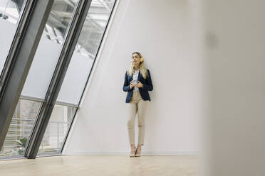 Young businesswoman in office having a break - JOSF03867