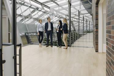 Business people talking in modern office building - JOSF03903