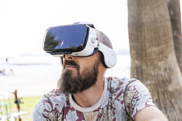 Mature man with virtual reality glasses - TCF06233