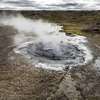 Volcanic spring, view of a natural hot spring and pool of hot water, Hunavatnshreppur, Nordurland Vestra, Iceland - CUF53583