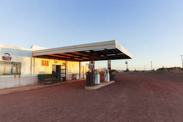 Abandoned gas station and garage at sunset - HOXF04638