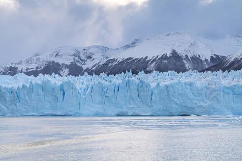 Southern terminus of Perito Moreno glacier under a moody sky, Los Glaciares National Park, UNESCO World Heritage Site, Santa Cruz, Argentina, South America - RHPLF13155
