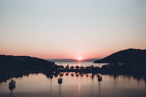 Scenic view of lake against clear sky during sunset - CAVF70731