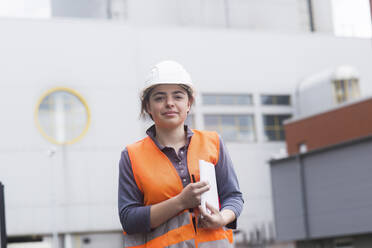 Portrait of confident female worker at power plant - SGF02495
