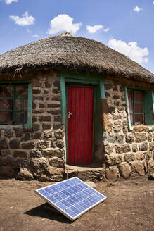 Traditional house with a solar panel, Lesotho - VEGF01175